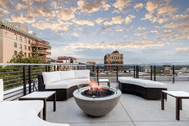 Patio fire pits with a view of downtown at Hemingway's Cuba at The Cambria