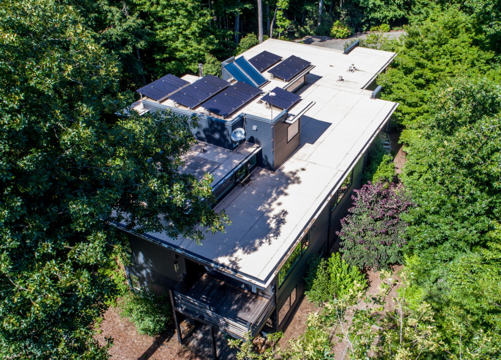 Aerial view of a home with solar panels