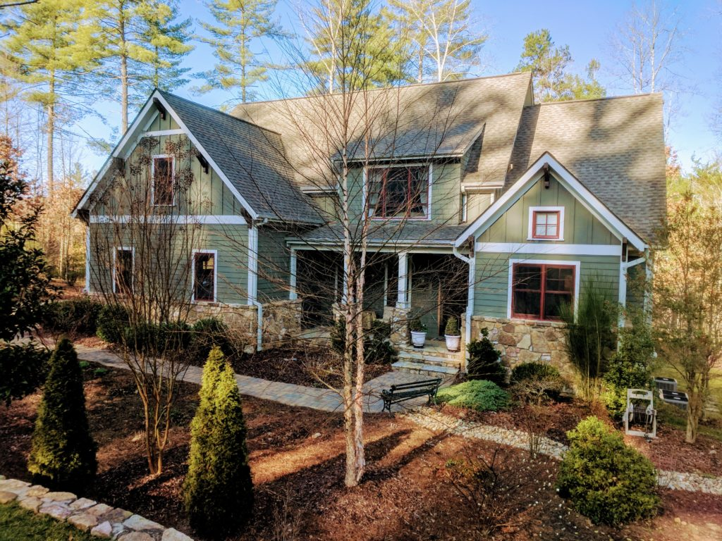 Craftsman style home with landscaping