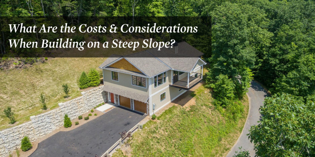 Two story home with multiple door garage that's built on a steep slope next to a road.
