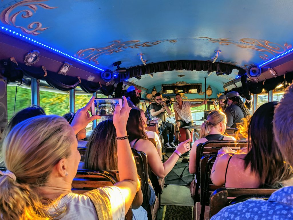 Live band performing for guests on LaZoom Bus Tours