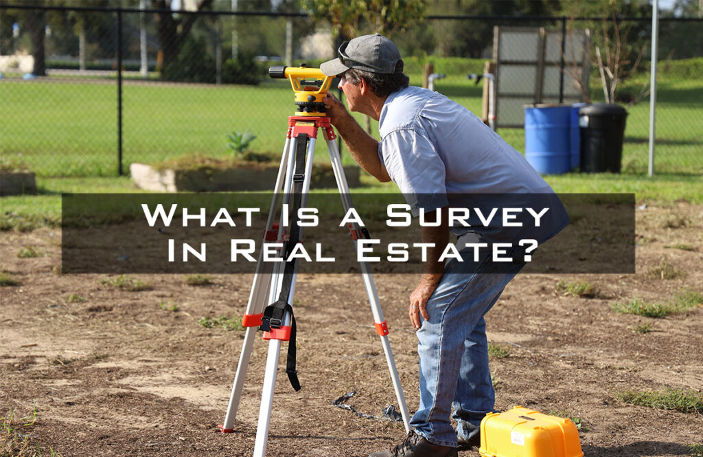 Man looking through a survey tripod