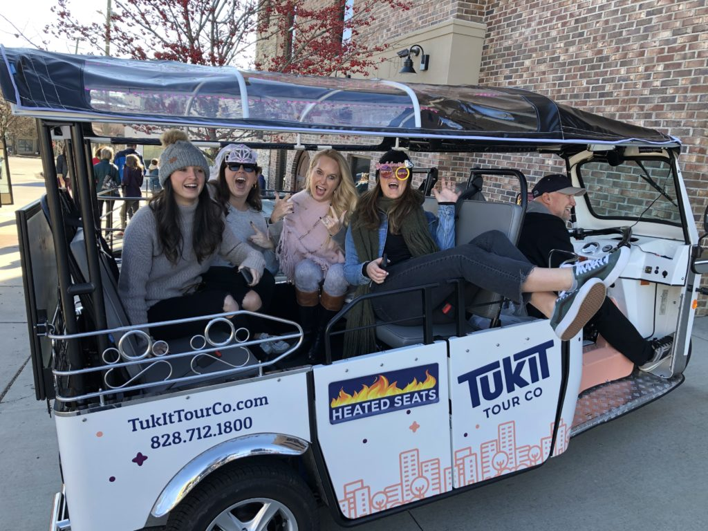 Customers celebrating on private TukIt Tour in Asheville